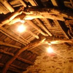 The original cruck roof of the barn. Made from driftwood it utilised part of a ship's mast, and an oar.