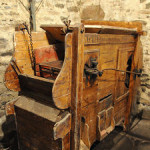 Grain threshing machine located in the barn